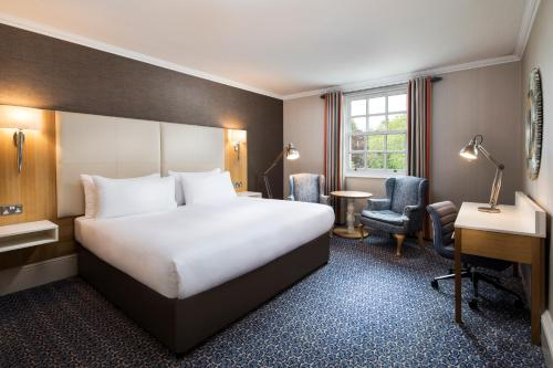 A bed or beds in a room at Oulton Hall Hotel, Spa & Golf Resort
