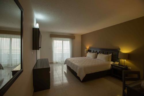 Cama o camas de una habitación en Ocean View Cancun Arenas