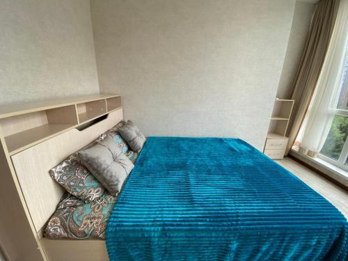 A bed or beds in a room at Большие Апартаменты возле моря