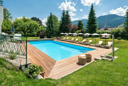 The swimming pool at or near Tennerhof Gourmet & Spa de Charme Hotel