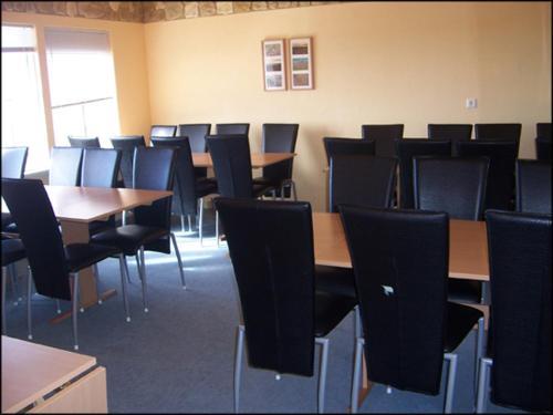 Un restaurante o sitio para comer en Guesthouse Hof