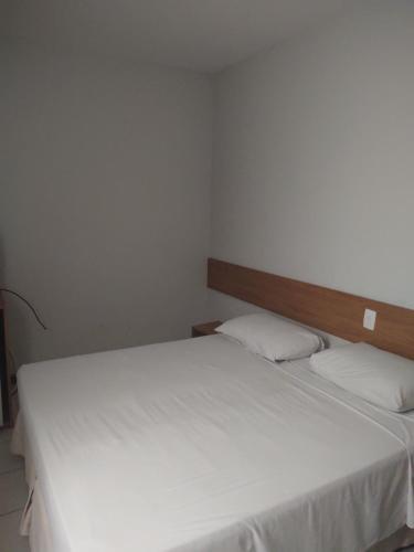 A bed or beds in a room at Pousada Pedra da Concha