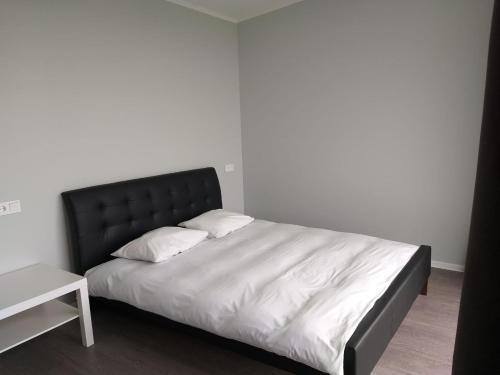 A bed or beds in a room at Atpūtas vieta Ežezers