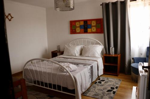 A bed or beds in a room at Casa Teresinha