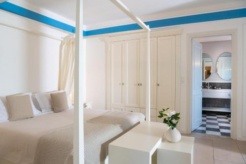 A bed or beds in a room at Pleiades Luxurious Villas
