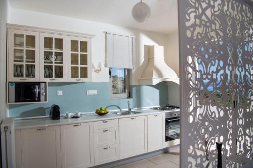 A kitchen or kitchenette at Pleiades Luxurious Villas