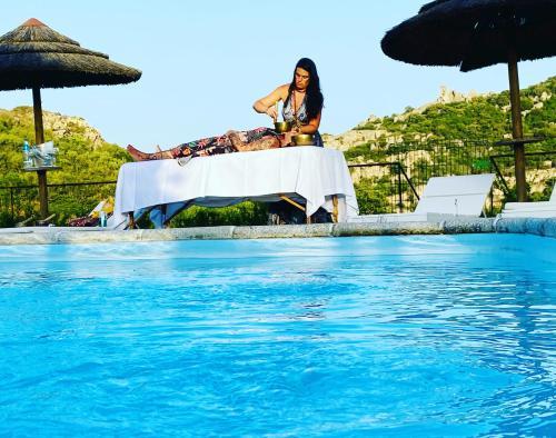 The swimming pool at or near Il Nuraghe del lago Coghinas