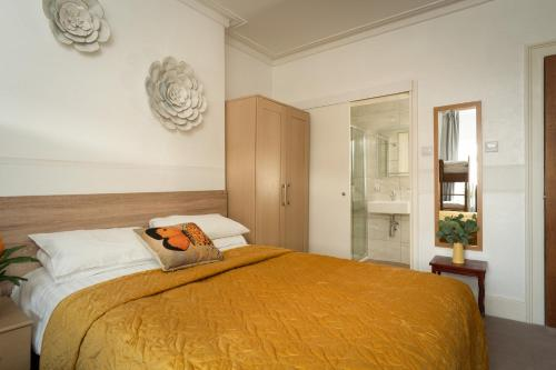 A bed or beds in a room at Torland Seafront Hotel - all rooms en-suite, free parking, wifi