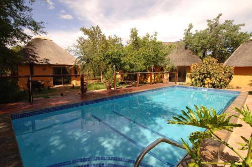 The swimming pool at or near Normann Safari Bush Lodge