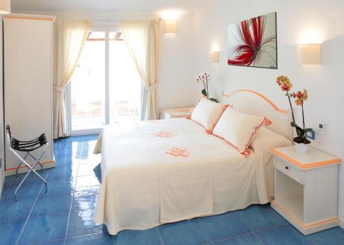 Кровать или кровати в номере Janas Hotel