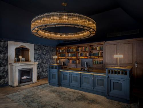 A kitchen or kitchenette at The Queens - QHotels