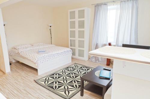 Кровать или кровати в номере Leader NORD Apartments on Krasnaya Presnya