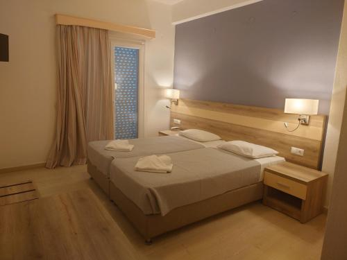 A bed or beds in a room at Ifigenia Hotel
