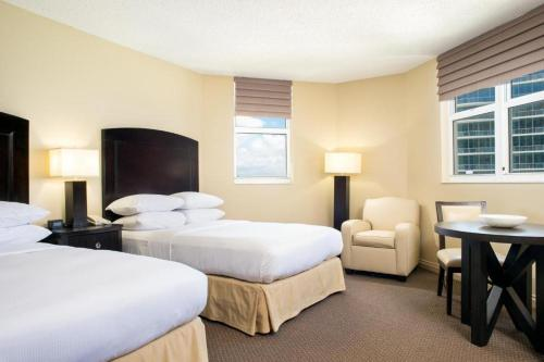 A bed or beds in a room at DoubleTree by Hilton Ocean Point Resort - North Miami Beach