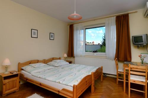 A bed or beds in a room at Vincze Vendégház
