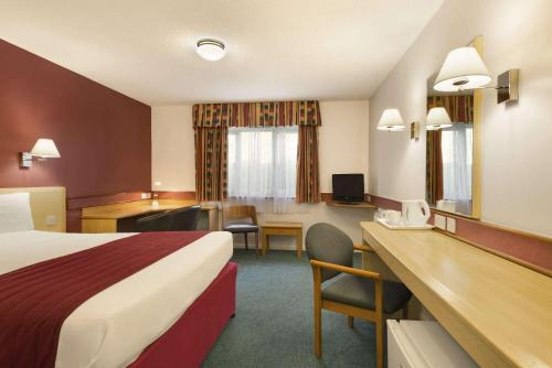 A television and/or entertainment center at Days Inn Hotel Bradford - Leeds