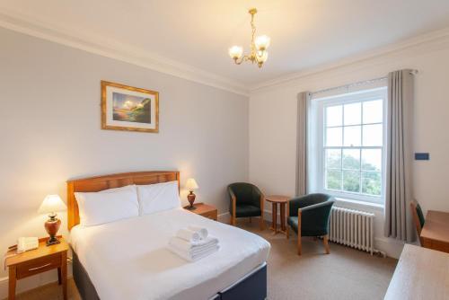 A bed or beds in a room at Tregenna Castle Resort