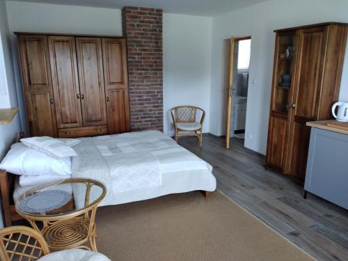 Łóżko lub łóżka w pokoju w obiekcie Mazurskie Żurawisko