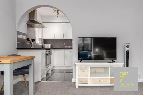 A television and/or entertainment center at GuestReady - Cosy Wimbledon Studio Flat