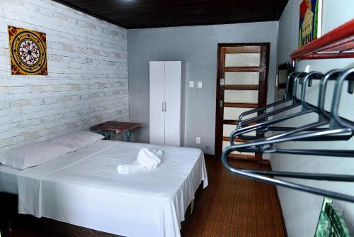 A bed or beds in a room at Pousada Cor e Arte - Pelourinho