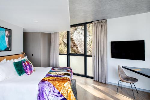 A bed or beds in a room at Crystalbrook Vincent - Formerly The Fantauzzo