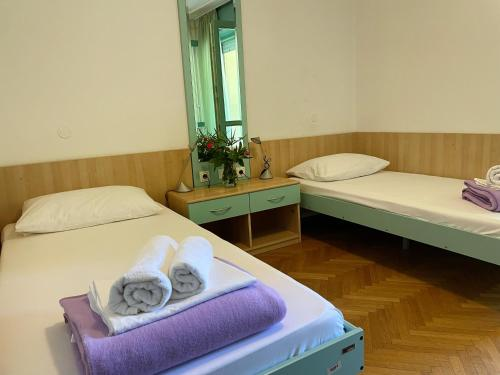 A bed or beds in a room at Hostel Spinut
