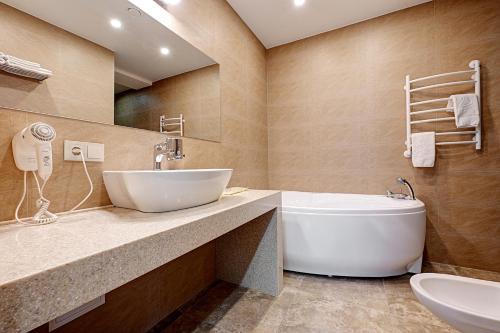 Ванная комната в Hotel Berg Haus