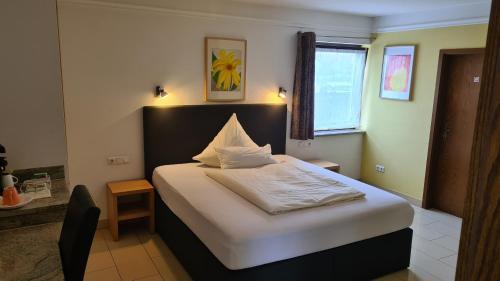 Ein Bett oder Betten in einem Zimmer der Unterkunft Business Pension Gasper