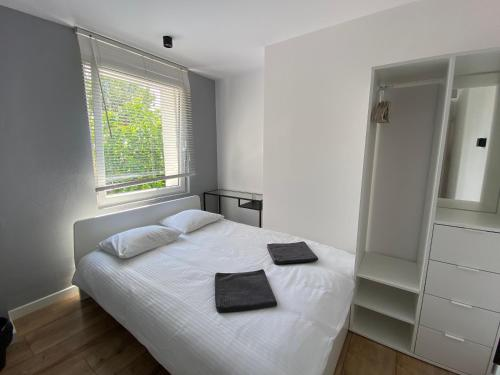 A bed or beds in a room at Hostel 19 Sopot