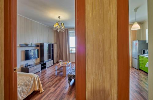 Гостиная зона в Apartments Podlesnaya 43A