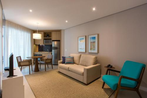 Uma área de estar em Book Santos Apartamentos Estanconfor