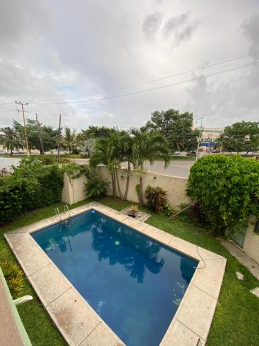 The swimming pool at or near Orquídeas