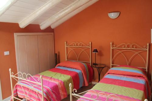 Letto o letti in una camera di Hotel Porta Santa Maria
