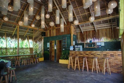 The lounge or bar area at Hiraya Surf Hostel