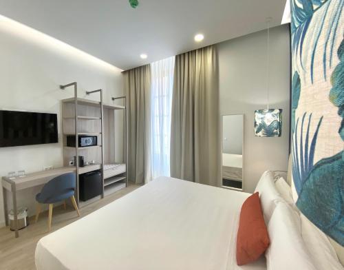 Een bed of bedden in een kamer bij Soho Boutique Urban