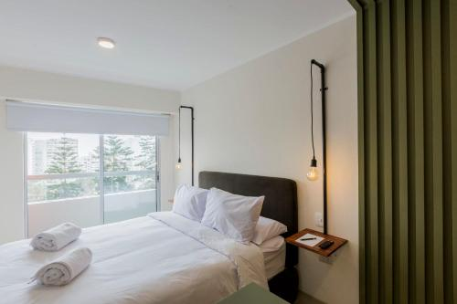 A bed or beds in a room at Amazing Loft in Barranco