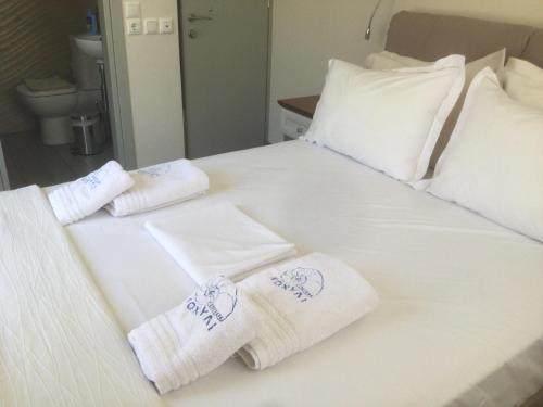 Ένα ή περισσότερα κρεβάτια σε δωμάτιο στο Kochyli Hotel