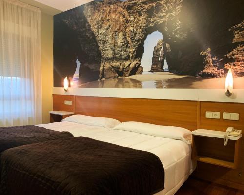 Letto o letti in una camera di Hotel Bello