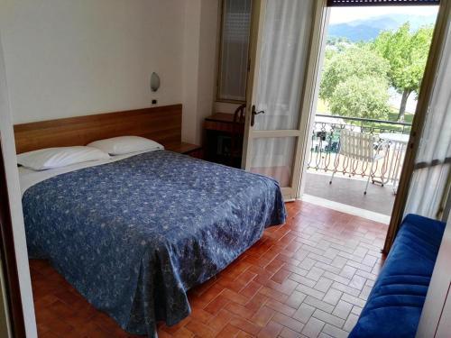 Letto o letti in una camera di Hotel La Romantica