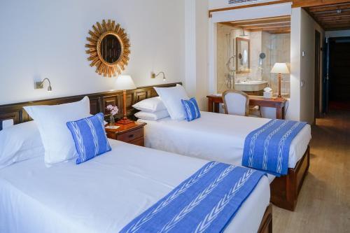 Säng eller sängar i ett rum på Hotel Bon Sol Resort & Spa
