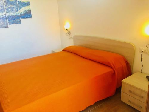 A bed or beds in a room at Case Vacanze Budoni Beach