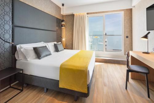 Un ou plusieurs lits dans un hébergement de l'établissement Catalonia Giralda