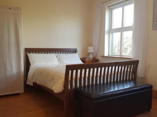 A bed or beds in a room at Seashells B&B