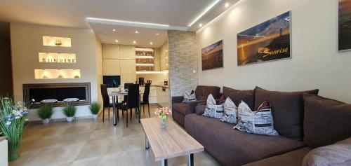 A seating area at Apartment Sunrise