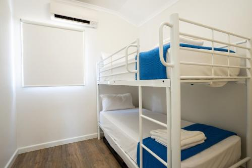 A bunk bed or bunk beds in a room at Darwin FreeSpirit Resort