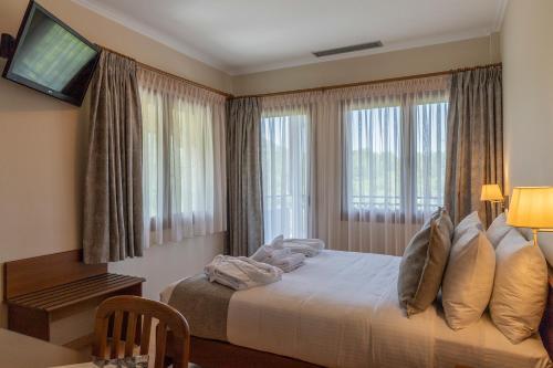 Ένα ή περισσότερα κρεβάτια σε δωμάτιο στο Ξένιος Δίας