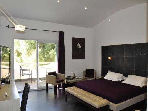 Un ou plusieurs lits dans un hébergement de l'établissement Private Hôtel