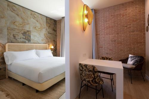 A bed or beds in a room at Atocha Hotel Madrid, Tapestry Collection by Hilton