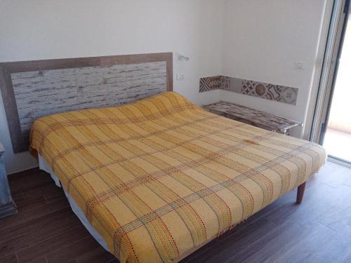 A bed or beds in a room at Buenavistasurfmed
