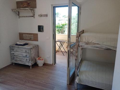 A bunk bed or bunk beds in a room at Buenavistasurfmed